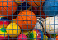 Collection of different balls in a metal cage Stock Image