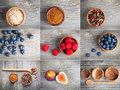 Collection of different spices and berry on wooden background Royalty Free Stock Photography