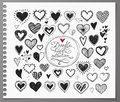 Collection of doodle sketch hearts hand drawn with ink and isolated on realistic lined paper. Royalty Free Stock Photo