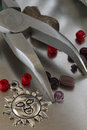 Collection of fashion jewelry items and forceps