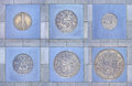 Collection of former dutch coins in pavement cemented sidewalk fit a frame Royalty Free Stock Photos