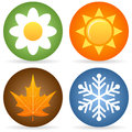 Collection four rounded seasons icons daisy flower spring sun summer leaf autumn snowflake winter Stock Images