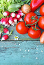 A collection of fresh vegetables on the old wooden table Stock Photography