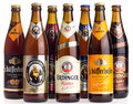Collection of German wheat beers on white