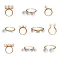 Collection of golden pearl rings isolated on white Royalty Free Stock Photo