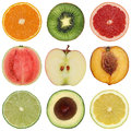 Collection of healthy sliced fruits like oranges peaches lemons and apples Stock Photo