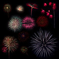 Collection of multi colored fireworks on a black background Stock Photos
