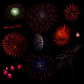 Collection of multi colored fireworks on a black background Stock Image