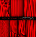 Collection of red curtains with shadows and glare