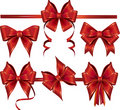 Collection of red gift bows with ribbons. Royalty Free Stock Photo