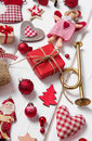 Collection of red and white checkered christmas decoration on wo
