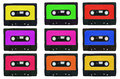 Collection of retro cassete tapes with multicolored stickers iso this image represents isolated on white Royalty Free Stock Images