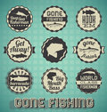 Collection of retro style gone fishing labels and icons Royalty Free Stock Images