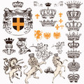 Collection or set of vintage styled heraldic elements horses unicorn lion shields crowns and other Royalty Free Stock Photo