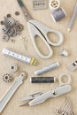 A collection of sewing needlecraft dressmaking tailoring tools and items in harmonising neutral greys and beige Royalty Free Stock Photos