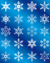 Collection of snowflakes on a blue background Royalty Free Stock Photo