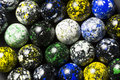 A collection of speckled marbles Stock Photo