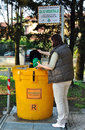 Collection of used vegetable oil in italy april bellusco woman poured cooking into a recycling bin so it can be converted into Royalty Free Stock Image