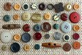 Collection of Vintage Buttons Scattered on Fabric Background Stock Images