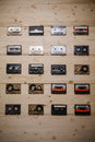 Collection of vintage Compact Cassettes on Wooden background Royalty Free Stock Photo