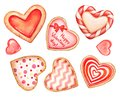Collection of watercolor heart shaped cookies and candies decorated with glaze on white background for Valentine`s day designs