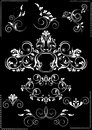 Collection white flourishes patterns on a black background for feel of pages Stock Photo