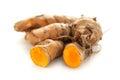 Collection of whole and sliced fresh Organic Long Turmeric (Curcuma longa).