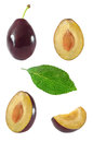 Collection of whole and sliced plum and leaf on white background isolated with clipping path Royalty Free Stock Photo