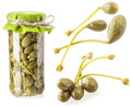 Collections of capers preserved in glass jar isolated on white Stock Photo