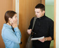 Collector is trying to get the arrears from woman women at home door Stock Photo