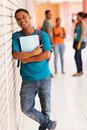 College boy books handsome african standing with against the wall Stock Images