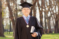 College dean posing with a book in the yard Royalty Free Stock Photos