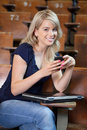College girl texting portrait of young using cell phone Royalty Free Stock Photo