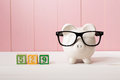529 college savings plan theme with white piggy bank with Eyeglasses Royalty Free Stock Photo