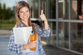 College student giving thumbs up candid portrait of a to camera Royalty Free Stock Photo