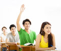 College student raise hand for question in classroom Royalty Free Stock Photo