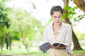 College student reading a book in park Royalty Free Stock Image