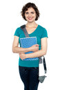 College student with stylish sling bag and notebook Stock Photo