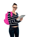 College student using tablet pc smiling university operating her Stock Images