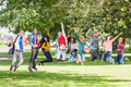 College students jumping in the park full length of a group of Royalty Free Stock Photos