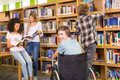 College students in library Royalty Free Stock Photo