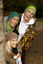 College students in park having fun smiling Royalty Free Stock Photos