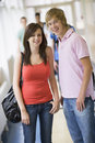 College students standing in university corridor Royalty Free Stock Images