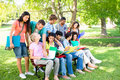 College students studying on campus group of multiethnic Stock Photo