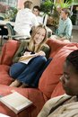 College Students Studying In Common Room Royalty Free Stock Images