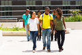 College students walking campus group of happy african american on modern Stock Photo
