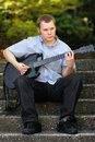 College Teenager with Guitar Stock Photo