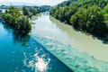 Colliding rivers in geneva two junction the rhone and the arve switzerland the river on the left is the rhone which is just Royalty Free Stock Image