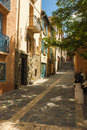 Collioure midday sun street with the deep shadow of a summer copyspace Stock Photo
