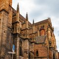 Colmar in Alsace, France. Collegiate Church of San Martino, one of the symbols of the city on the canals. Royalty Free Stock Photo